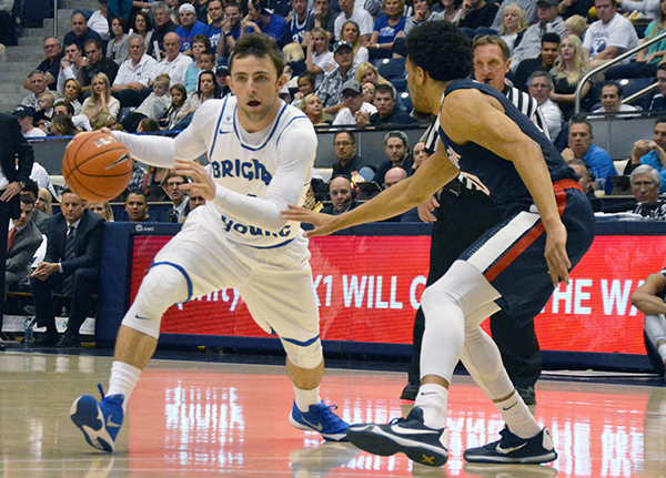 BYU freshman Nick Emery dribbles past a Gonzaga player in a game at the Marriott Center. (Photo by Rebecca Lane)