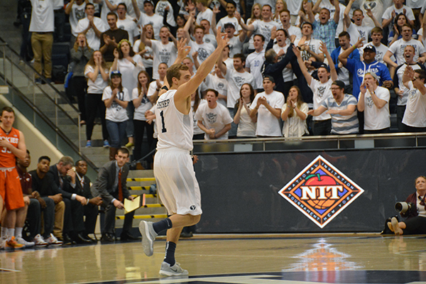 BYU senior Chase Fischer flashes the crowd a three after scoring a 3-pointer in BYU's NIT game against Virginia Tech. Fischer scored the last 12 points of the game for the Cougars. (Photo by Rebecca Lane)