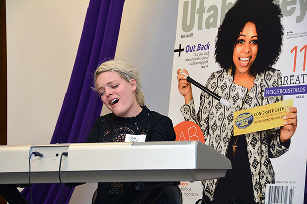 "Orem's Jenn Blosil, an ""American Idol"" top 14 finisher, performs two original pieces at the Utah Valley Magazine Fab 40 party on Thursday afternoon. (Photo by Dave Blackhurst)"
