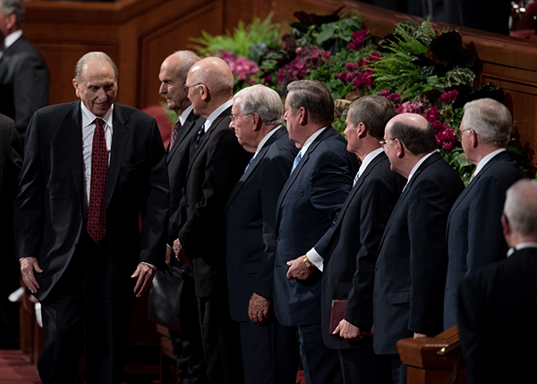 LDS Church President Thomas S. Monson walks past members of the Quorum of the Twelve at the Conference Center in Salt Lake following a session of general conference. (Photo courtesy LDS Church)