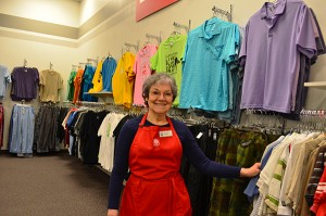 Sonia Broines, men's clothing associate on the sales floor, keeps the men's area organized at the front of the thrift store. (Photo by Matt Bennett)
