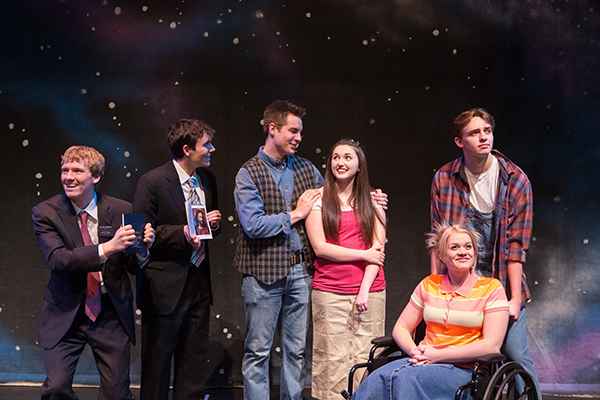 "The SCERA is performing ""Saturday's Warrior"" through April . The cast from left to right: Tanner Perkins is Jimmy (overalls, flannel shirt); McKenna Hixson is Pam (wheelchair); Kelsea Kocherhans is Julie (long brown hair, pink shirt, tan skirt); Alex Pierson is Todd (vest); Chris Rollins is Elder Kestler (brown hair) and Eric Taylor is Elder Greene (blonde hair). (Photo by Savanna Sorensen)"