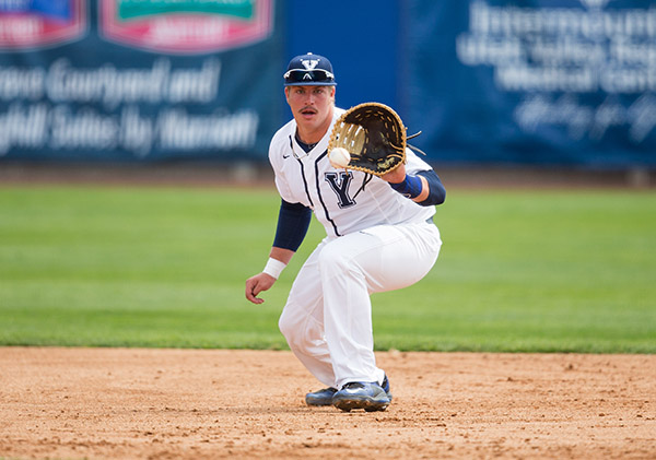 BYU baseball's Colton Shaver catches a ball at a game against Arizona earlier this season. (Photo by BYU Photo)