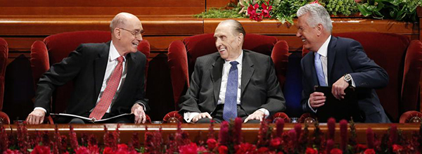 The First Presidency of The Church of Jesus Christ of Latter-day Saints interact during the Women's Session of the 186th Annual General Conference. From left to right, President Henry B. Eyring, President Thomas S. Monson and President Dieter F. Uchtdorf. (Photo courtesy LDS Church)