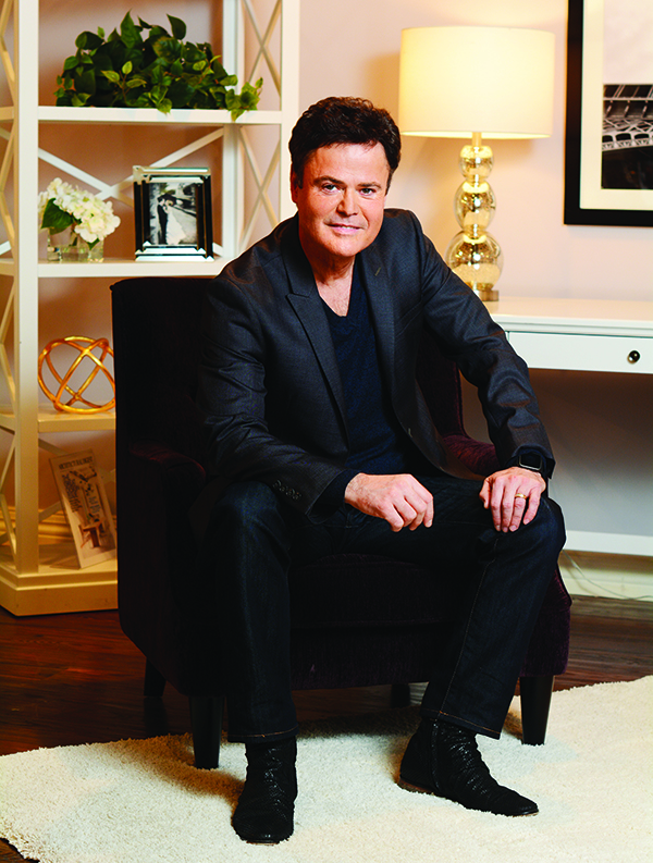 "Donny Osmond is writing a new ""verse"" with Donny Osmond Home, a line of furniture he is designing with his wife, Debbie. Osmond Designs is carrying the right-priced, durable, trendy line of furnishings. Donny and Debbie have remodeled their Provo and Las Vegas homes — as well as Donny's dressing room at The Flamingo — with their self-named interior design options. (Photo by Dave Blackhurst)"