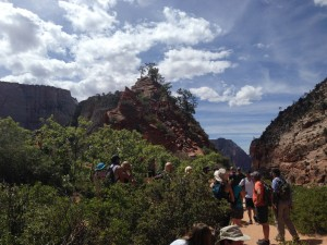 Hikers descend the chains leading to the last stretch of the Angels Landing hike in Zion National Park. (Photo by Christa Woodall)