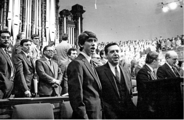Elder Holland and his son Matt sing during a meeting in the Salt Lake Tabernacle. (Photo courtesy LDS.org.)