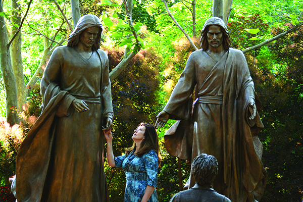 """This Is My Beloved Son"" is the only non-New Testament depiction in the Light of the World Garden and represents Joseph Smith's experience known as the First Vision in the LDS faith. The surrounding grove was not created for this sculpture location. This tree-lined area is tucked on the west side of the exhibit, which is in the former Butterfly Garden."