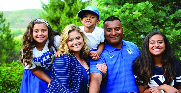 "Kalani and Timberly Sitake met at a Sub for Santa dance at BYU, and now they are raising Skye (12), Sadie (9) and KK (5) in the town Kalani considers home. ""I remember driving down I-15 when I was younger and knowing where we were by how the air smelled,"" Kalani says. ""Even with my eyes closed, I could tell if we were passing Geneva or if we were close to the Point of the Mountain. I love this valley.""  (Photo by Dave Blackhurst)"
