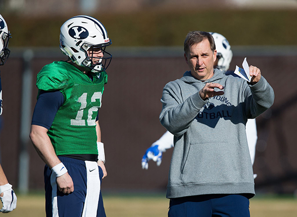 BYU offensive coordinator Ty Detmer coaches BYU sophomore quarterback Tanner Mangum during spring practice. (Photo by BYU Photo)