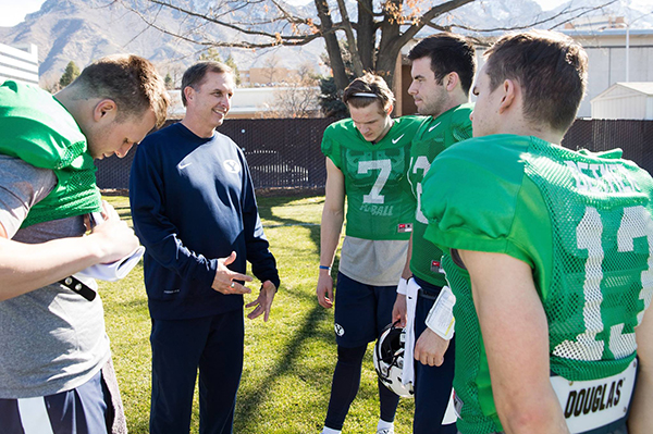 Ty Detmer, offensive coordinator for BYU football, coaches the quarterbacks during spring practice. (Photo by BYU Photo)