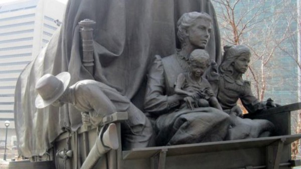 Pioneer Courage Park, located between 14th Street and 15th Street on Capitol Avenue in downtown Omaha, includes a series of sculptures depicting a wagon train of four pioneer families and their covered wagons departing westward. (Photo courtesy Mormon Newsroom.)