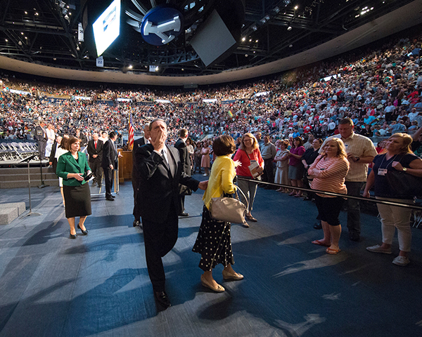 Elder Jeffrey R. Holland blows a kiss to the crowd at the Marriott Center after his BYU Education Week devotional on Tuesday morning. (Photo by Mark A. Philbrick/BYU Photo)
