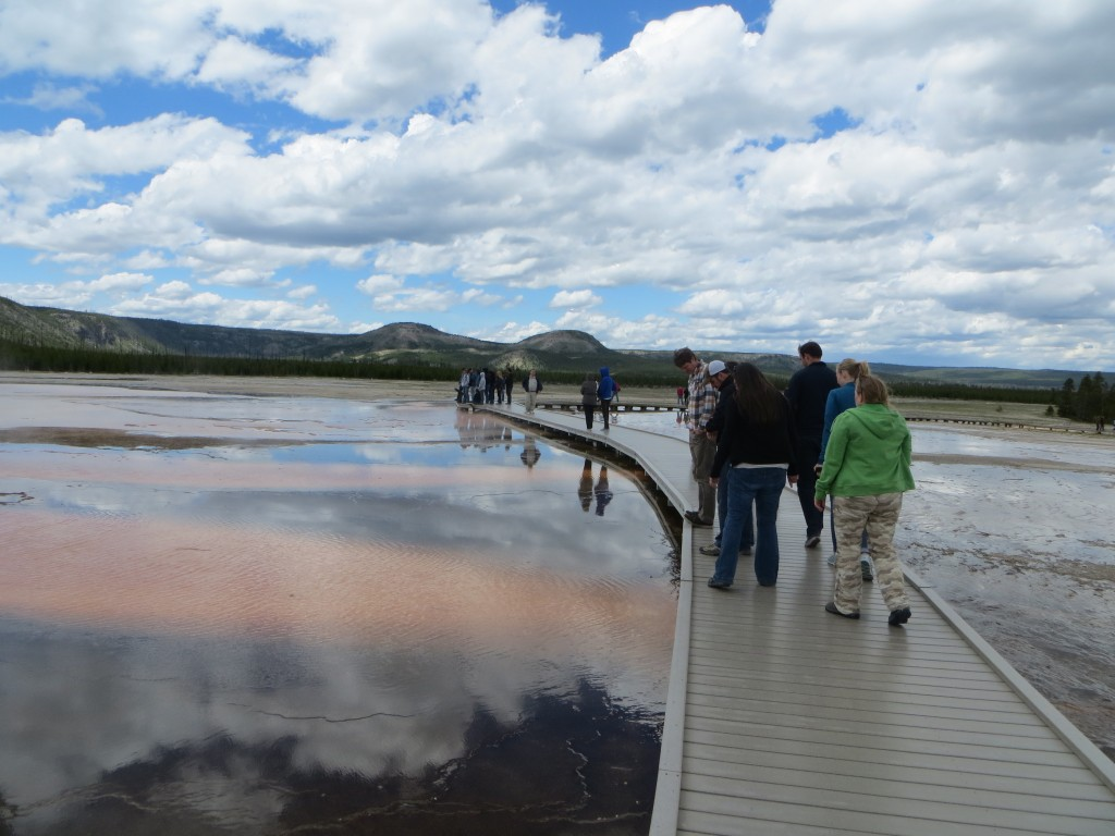 A group of travelers from Utah takes in the sights along the boardwalk of Midway Geyser Basin in Yellowstone National Park. (Photo by Christa Woodall)