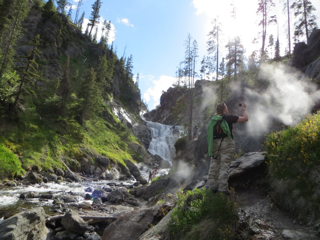 Steam rises from where hot springs feed the river at Mystic Falls, one of several hikes at Yellowstone National Park. (Photo by Christa Woodall)
