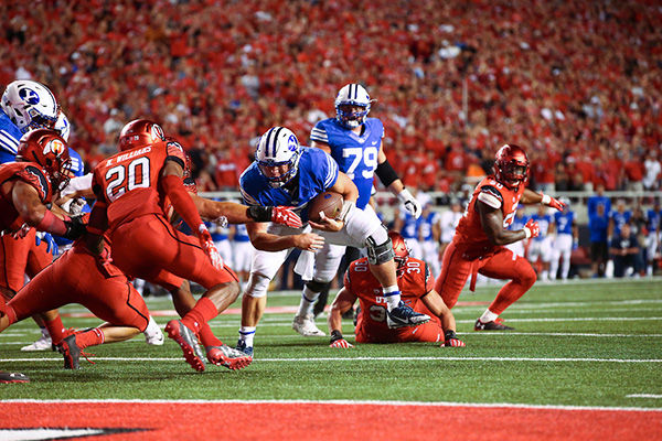 BYU quarterback Taysom Hill rushes forward in the failed 2-point conversion play in the 20–19 loss to Utah Saturday night. (Photo by BYU Photo)