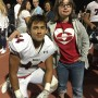 Taylee Smith, right, came to support Bradley Nicol, left, at his football game after being invited to homecoming by Nicol with a unique vidoe. (Photo courtesy Bradley Nicol)
