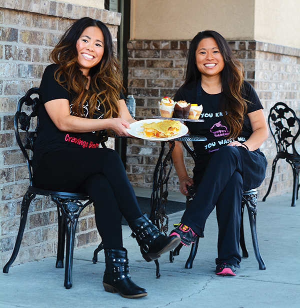 "Twin sisters own Cravings - Alisha's Cupcakes and Cravings Bistro in Pleasant Grove. Together, Angie (left) and Alisha won ""Cupcake Wars"" on the Food Network and enjoy serving up happiness to their customers."