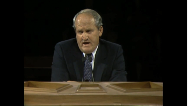 Then-head BYU football coach LaVell Edwards addresses priesthood holders during the October 1984 priesthood session. (Screen shot via LDS.org.)