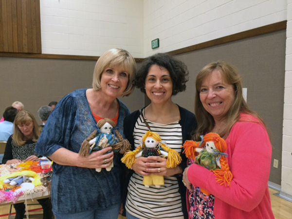 Provo's Carolina Allen (center) is the founder of Big Ocean and has partnered with American Fork's Launfal Foundation, which has donated 100 school bags, 100 handmade dolls and wooden toys for humanitarian efforts in Quito this week. (Photo courtesy Big Ocean)