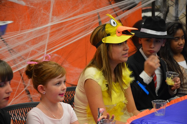 A girl reacts to the food in Fear Factor at the Provo Halloween Carnival. (Photo by Rebecca Lane)