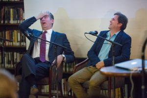 UVU President Matt Holland, left, and artist Tom Holdman share a laugh during the panel discussion at The General Society of Mechanics and Tradesmen of New York City lecture series in Manhattan Monday, Oct. 17. (Photo courtesy of UVU Marketing)