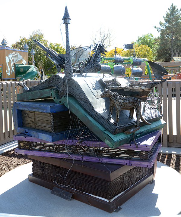 "A scrap metal piece, ""Land of Imagination,"" sits outside the All-Together Playground to encourage creativity and imagination. (Photo by Rebecca Lane/UV360)"