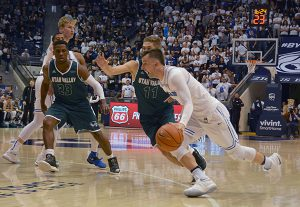 BYU sophomore Nick Emery drives past the UVU defense. Emery led the Cougars with 37 points. (Photo by Rebecca Lane/UV360)
