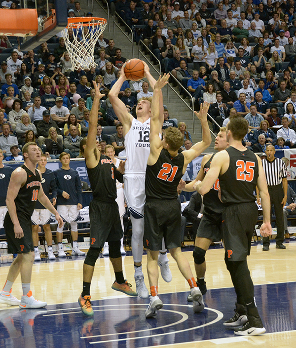 BYU sophomore Eric Mika pushes through the defense in the season-opener against the Princeton Tigers. Mika led the Cougars to a 82–73 victory with 26 points and 18 rebounds. (Photo by Rebecca Lane)