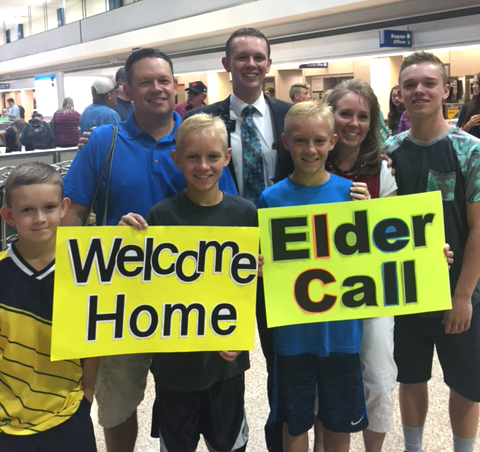 Jeff Call, top left, welcomes his oldest home from his LDS mission along with the rest of his family, except his second son, who is currently serving a mission. (Photo courtesy Jeff Call)
