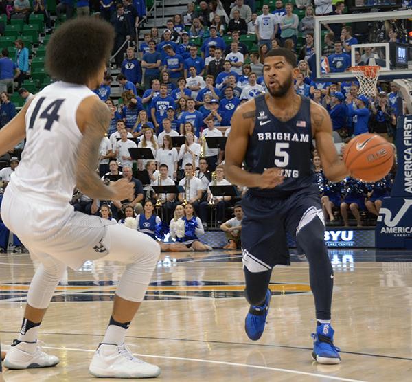 BYU senior L.J. Rose prepares to pass the ball during the BYU basketball game against Utah State. BYU won 77–62. (Photo by Rebecca Lane/UV360)