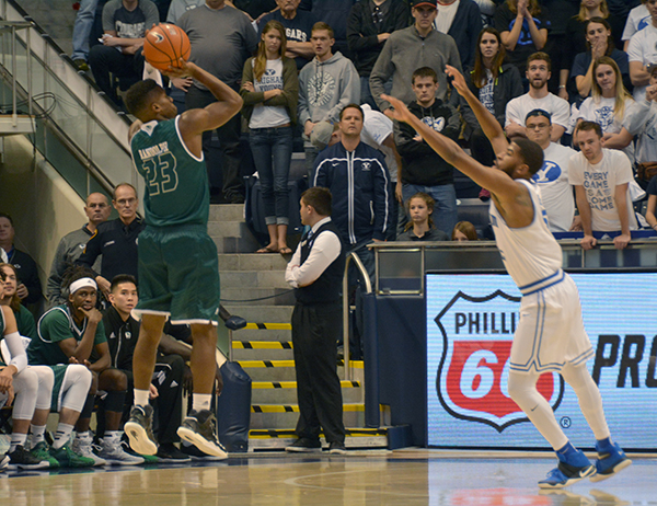 UVU junior Brandon Randolph shoots a three during the UCCU Crosstown Crash in the Marriott Center on Saturday. Randolph made three 3-pointers during the game and was UVU's second leading scorer with 21 points. (Photo by Rebecca Lane/UV360)
