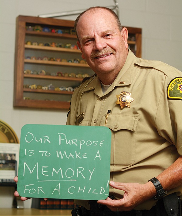 Lt. Tom Hodgson has run the Utah County Shop with a Cop program since it started in 1990. The initiative involves officers from every agency in the valley and has blessed thousands of children. (Photo by Dave Blackhurst/Utah Valley Magazine)