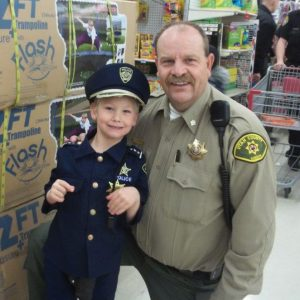 Lt. Tom Hodgson shops with one of the kids in the Shop With a Cop program.