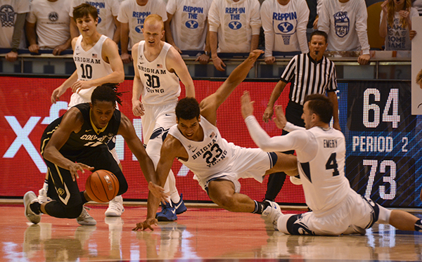 BYU freshman Yoeli Childs (23) and BYU sophomore Nick Emery (4) dive after the ball in a game against Colorado University at the Marriott Center Saturday night. The Cougars won 79–71. (Photo by Rebecca Lane/UV360)