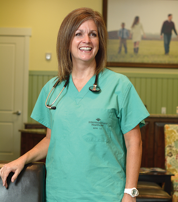 """""""Being a woman has only helped me as a physician in Utah Valley. I'd like to say I've been successful solely because I'm a great doctor. But I can't ignore the fact that there was a need in this valley for female physicians, and that's in some way contributed to my success,"""" Savage says. """"What's more, there were a few women before me who helped pave the way. We're all in this together."""" (Photo by Dave Blackhurst/UV BizQ)"""